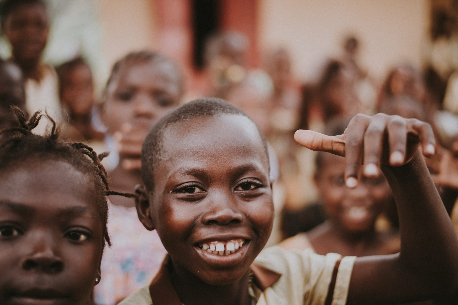 African children crowding and smiling. This image is different from the representation of Africa typically shown in the media